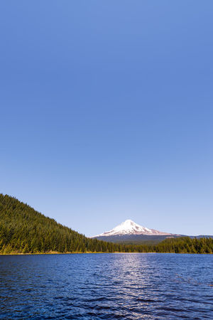 Vertical view of Mt. Hood and Trillium Lake in Oregon Cascade Cascade Mountains Forest Hood Lake Landscape Mount Hood Mountain Mountain Range Mt Hood Nature Oregon Pacific Northwest  Snow Tree Trees Trillium Trillium Lake Volcano Water Wilderness
