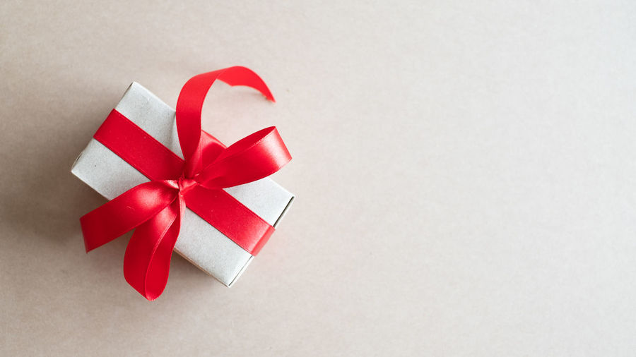 High angle view of christmas decorations on box against white background