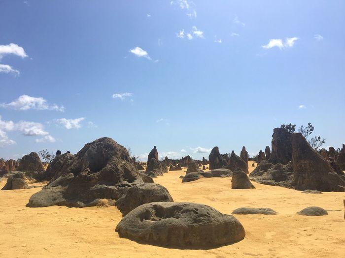 Rocks on land against sky
