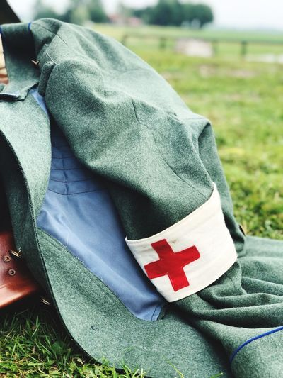 Re-enactment. WWII Ww2 Combat Medic  Patriotism Flag Close-up One Person Textile Focus On Foreground