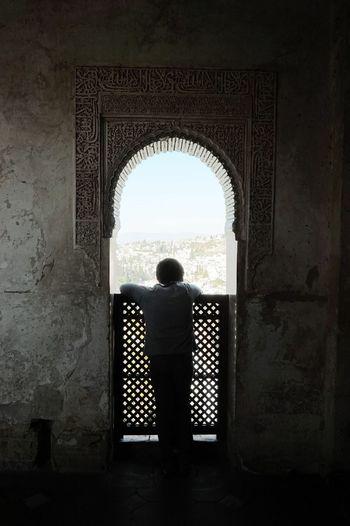 SPAIN Granada Alhambra Little Boy Window View Window Frame Shadow Silhouette