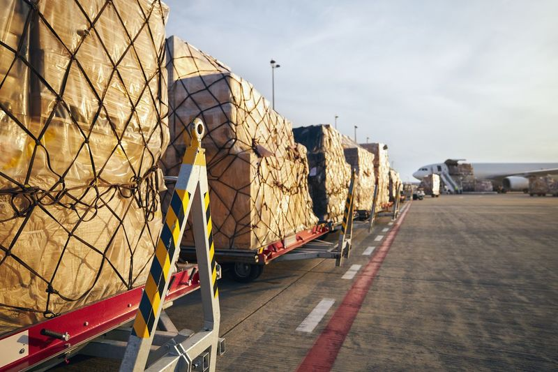 View of cargo on airport against sky