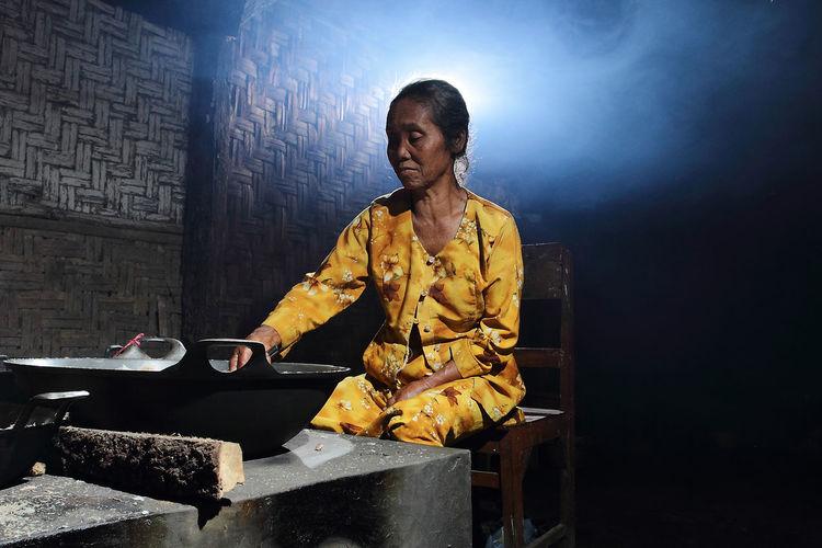 Woman preparing food in darkroom