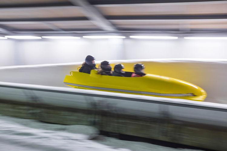 Man bobsledding on sports track