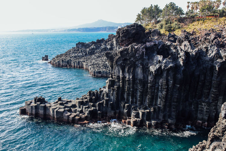 Jeju, South Korea Basalt Basalt Columns Beauty In Nature Blue Cliff Coastline Giant Jeju JEJU ISLAND  Jejudo Korea Rock Formation Sea Seoul Tranquility Travel Traveler Traveling Volcano Wanderlust Water Waterfront Wave