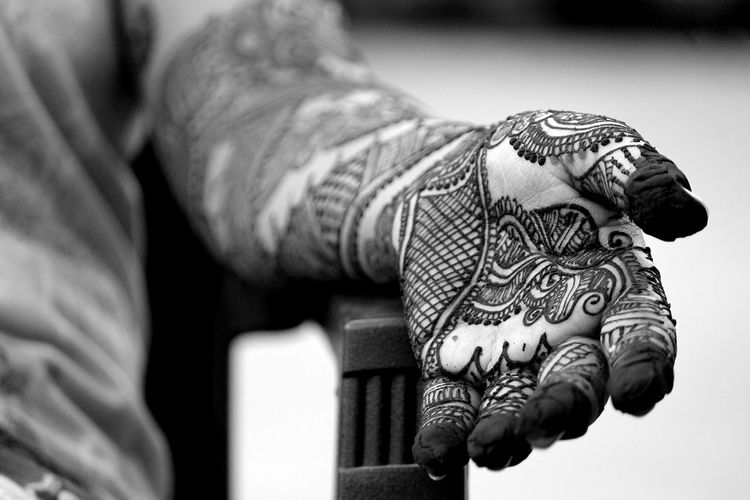 Woman Showing Her Hand Designed With Henna Tattoo
