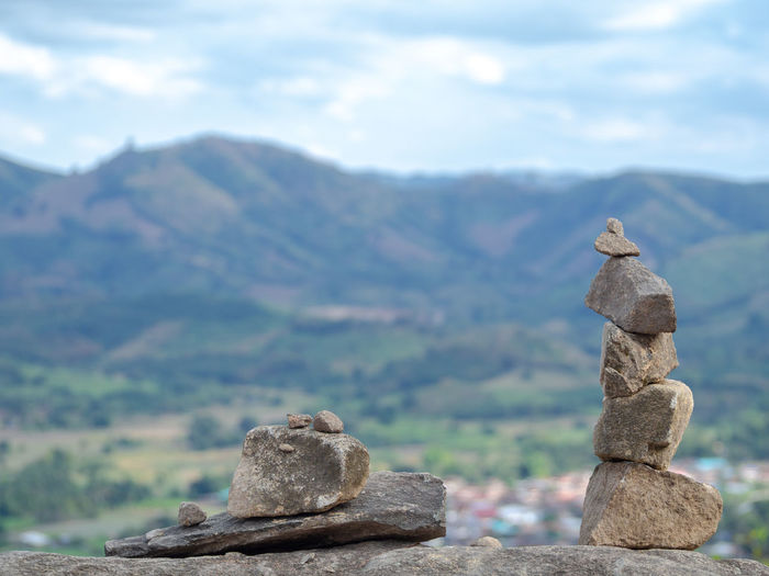 Stack of rocks against sky