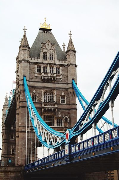 EyeEm LOST IN London Tower Bridge  Architecture Built Structure Connection Building Exterior Travel Destinations Bridge - Man Made Structure Outdoors Low Angle View City Travel Day No People Sky The Week On EyeEm Your Ticket To Europe The Graphic City