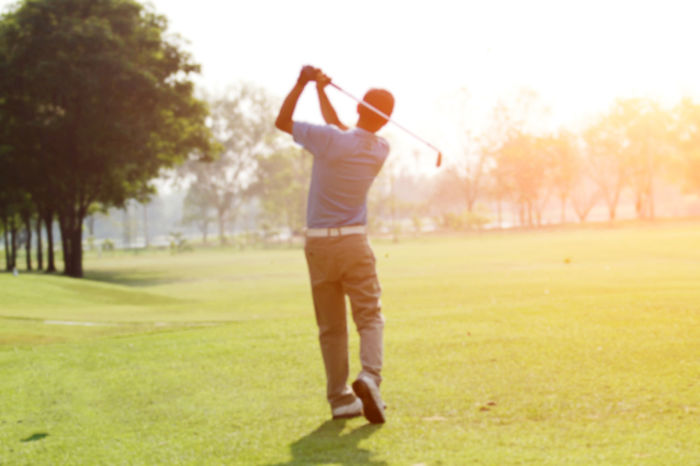 Adult Adults Only Day Full Length Golf Golf Ball Golf Club Golf Course Golf Swing Golfer Grass Green - Golf Course Leisure Activity One Man Only One Person Only Men Outdoors People Playing Sky Sport Sportsman Taking A Shot - Sport Tree Young Adult