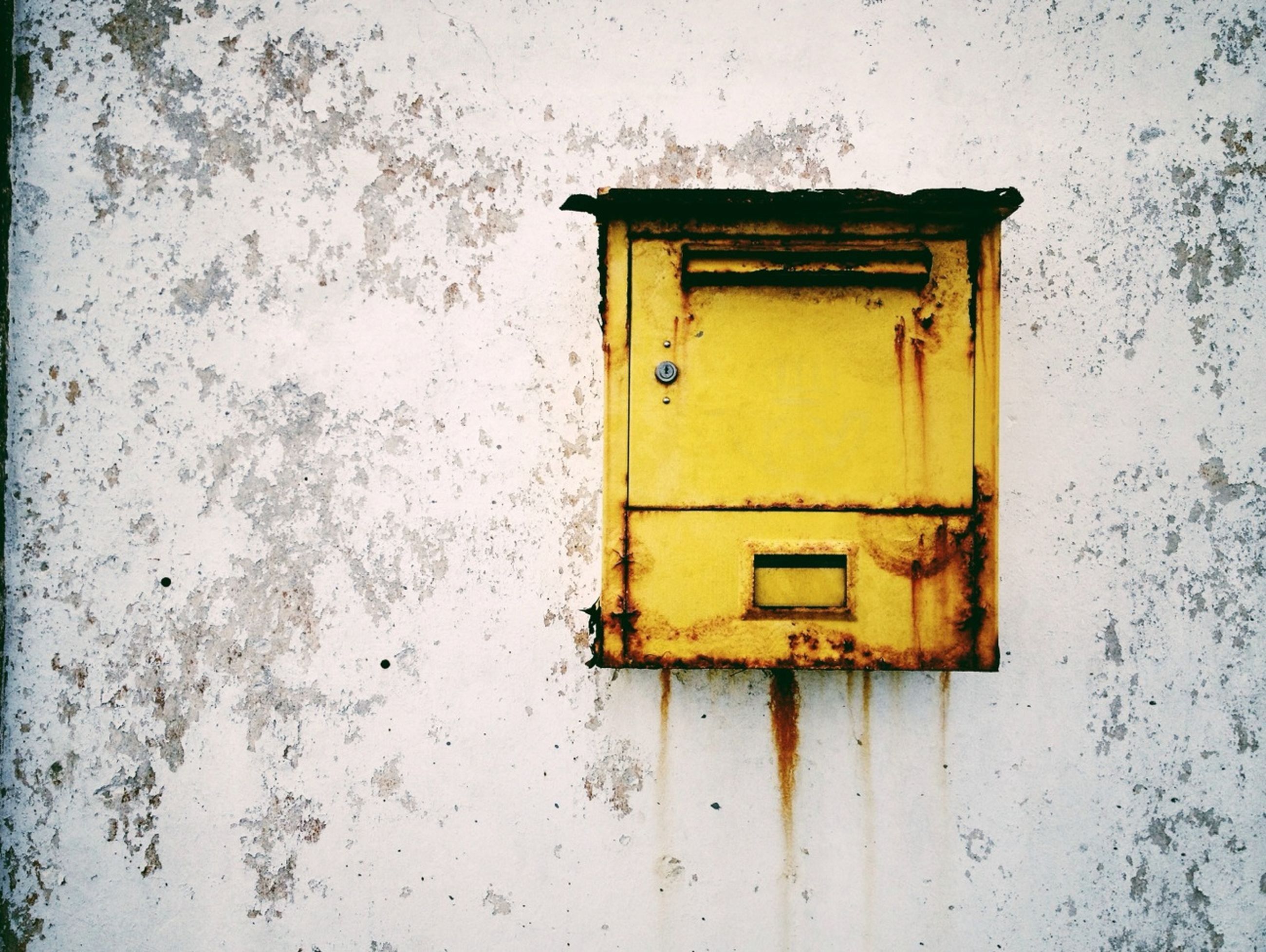 architecture, built structure, building exterior, yellow, wall - building feature, house, season, snow, cold temperature, door, weather, winter, window, wall, closed, residential structure, outdoors, no people, day, weathered