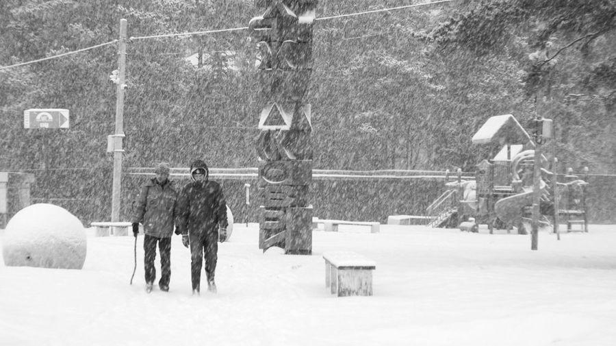 Through the snow Cold Temperature Day Men Nature Outdoors Real People Snow Two People Winter