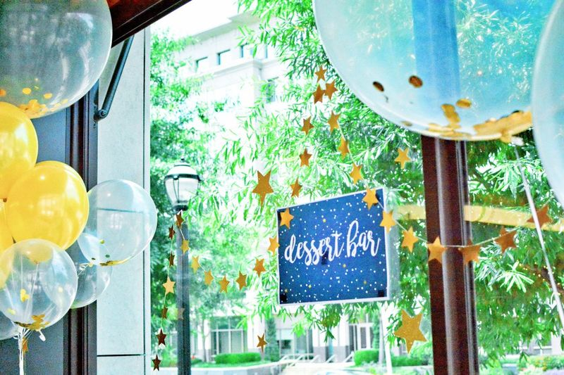 Text Communication No People Day Sign Plant Hanging Western Script Focus On Foreground Tree Information Food And Drink Indoors  Close-up Balloon Window Glass Information Sign Glass - Material Message