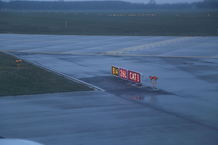 High Angle View Of Signboards On Runway During Foggy Weather