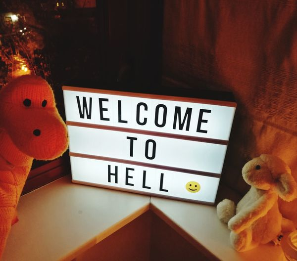Welcome to Hell. Funny Creepy Horror Menacing Plushy Soft Toys Dinosaur Lamb Lightbox Communication Text Close-up Information Sign Signboard