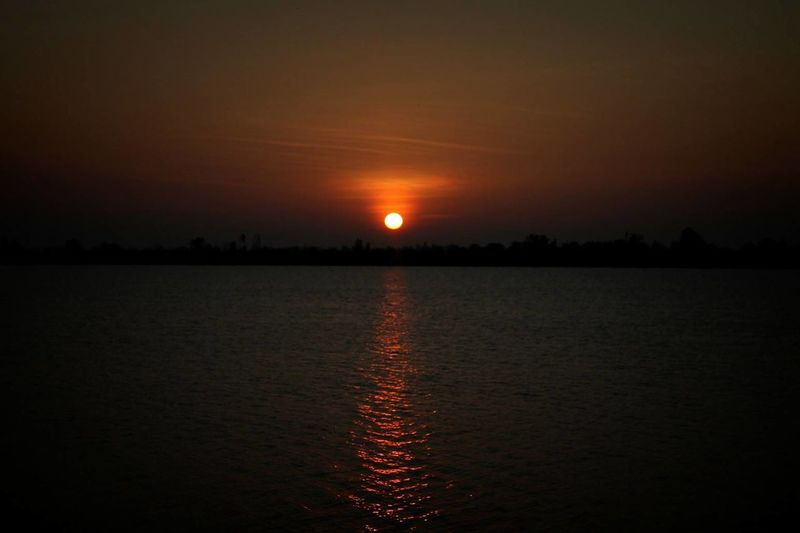 No People Day Sea Sun Up Sky Sunset Reflection Tranquility Tranquil Scene Scenics Moon Water Beauty In Nature Nature Outdoors Sun Lake Astronomy Tree