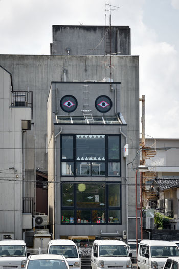 Travel Photography Architecture Building Exterior Built Structure Car City Concrete Concrete Building Day Emojis In The Wild Land Vehicle No People Outdoors Sky Street Art Transportation Monster Visual Creativity