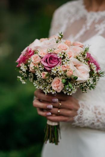 Wedding details, groom, bride, boquette, boutonnière
