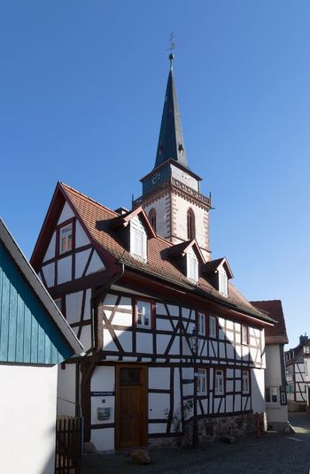 St. Ursula Church Tower in Oberursel's Old Quarter Hessen Taunus Oberursel Middle Ages Medieval Architecture Built Structure Sky Clear Sky Building Exterior Low Angle View Tower Sunlight Tall - High Tourism City Blue