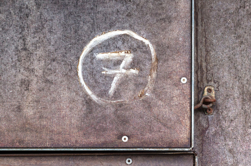 Close-up of number 7 on metal