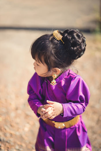 High angle view of cute baby girl standing on land