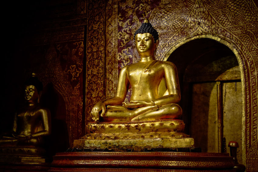 An Buddhist temple in Chiang Mai, Thailand. Chiang Mai | Thailand Thailand Buddhism Buddhist Temple Day Fujifilm Fujifilm_xseries Gold Gold Colored Golden Color Human Representation Idol Indoors  Low Angle View Male Likeness No People Place Of Worship Religion Sculpture Spirituality Statue