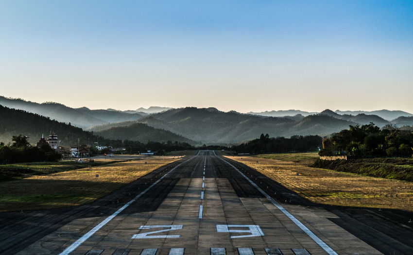 ASIA Thailand Airport Beauty In Nature Clear Sky Day Diminishing Perspective Landscape Maehongson ,Thailand Mountain Mountain Range Nature No People Outdoors Road Scenics Sky The Way Forward Tranquility Transportation Tree