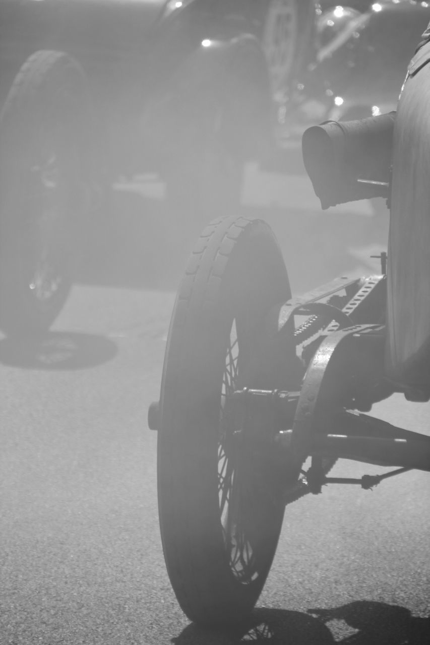 transportation, focus on foreground, mode of transport, land vehicle, street, close-up, motorcycle, wheel, outdoors, day, no people, tire
