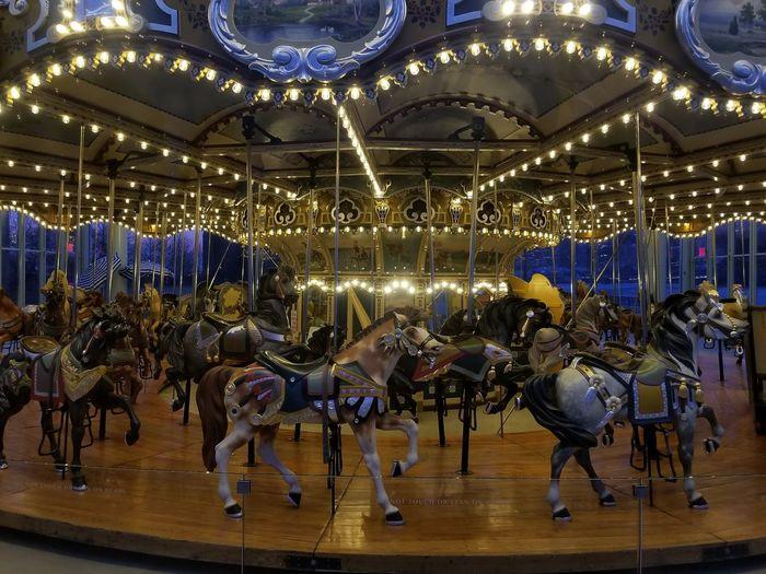 Carousel At Amusement Park During Night