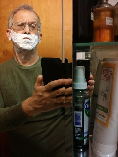 Selfportrait Self Portrait One Man Only One Person Gray Hair Eyeglasses  Shaving Cream Mirror Pic Interrupted Interruption WTF? Medicine Chest Reflections Portrait Indoors