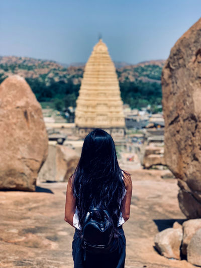 Rear view of woman looking at temple