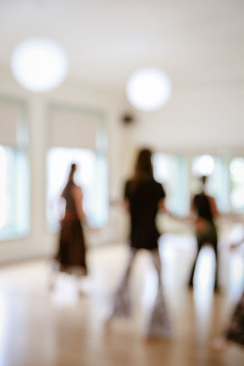 Nia Leisure Activity Standing Full Length Motion Architecture Lifestyles People Incidental People Blurred Motion Defocused Real People Walking Indoors  Women Adult Group Of People Out Of Focus