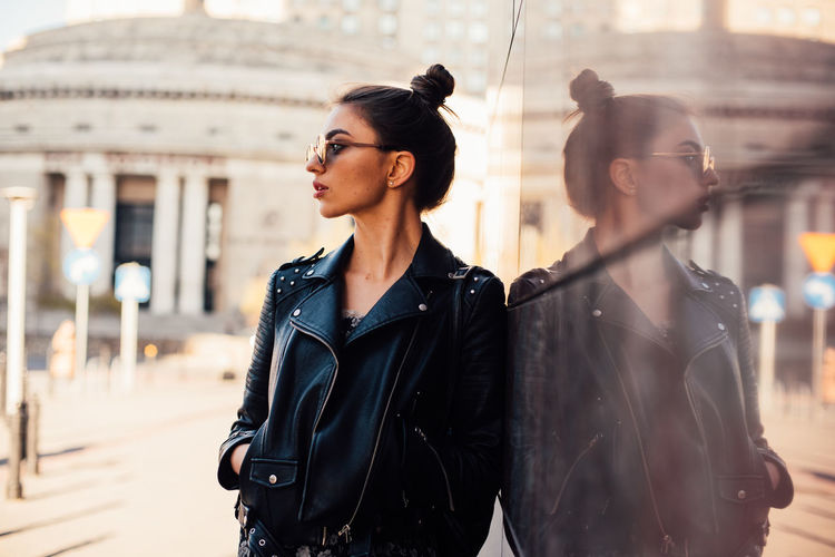 Daria The Week on EyeEm Light And Shadow Capture The Moment Beautiful Woman Woman Reflection Portrait Of A Woman Model Street Photography Nikon D750 Nikonphotographer Architecture Young Adult City Building Exterior Built Structure Lifestyles Young Women Waist Up People Real People Focus On Foreground Clothing Standing Looking Adult Leisure Activity Day Beauty Leather Hairstyle Outdoors Leather Jacket