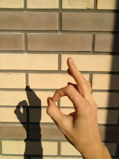 fingers show ok