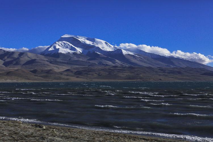 Na Munani Beauty In Nature Day Horizontal Lake Lake Manasarovar Landscape Mountain Mountain Peak Nature No People Outdoors Scenics Sky Snow Tibet Water 玛旁雍错 纳木那尼峰