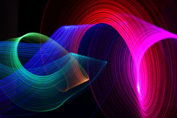 Abstract Image Of Light Painting Over Black Background
