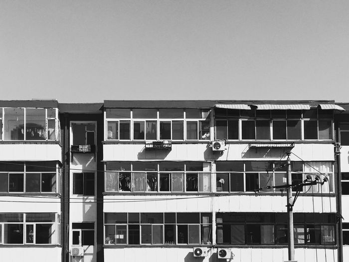 IPhone 7 Plus 男仔很忙 Blackandwhite Built Structure Building Exterior Architecture Sky Day Building Clear Sky Nature Outdoors Residential District No People Sunlight Mode Of Transportation Window Transportation City Railing Water Copy Space Balcony