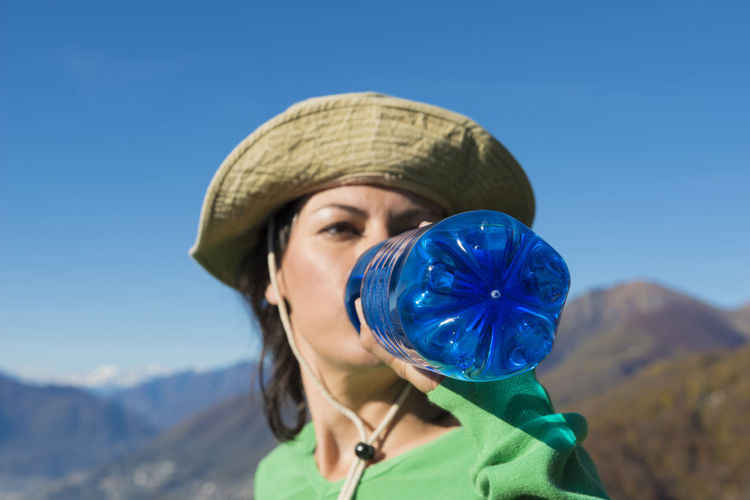 Close-Up Of Young Woman Against Clear Blue Sky