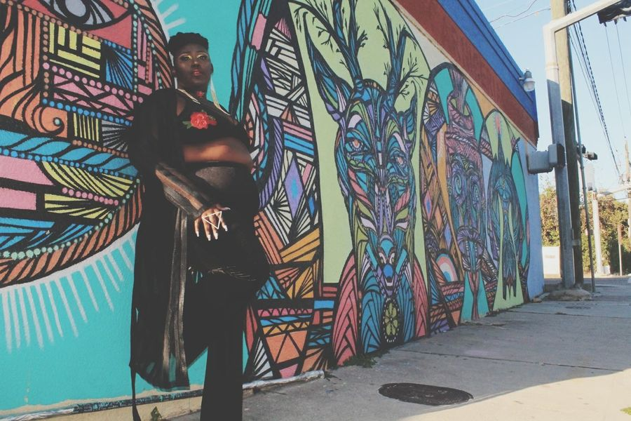 EyeEmNewHere Graffiti Multi Colored Street Art One Person People Full Length Plus Size Model Looking At Camera Houston Texas United States Texas Beauty Streetart/graffiti Bodypositive Black Fashion  High Fashion Individuality Arts Culture And Entertainment Outdoor Photography