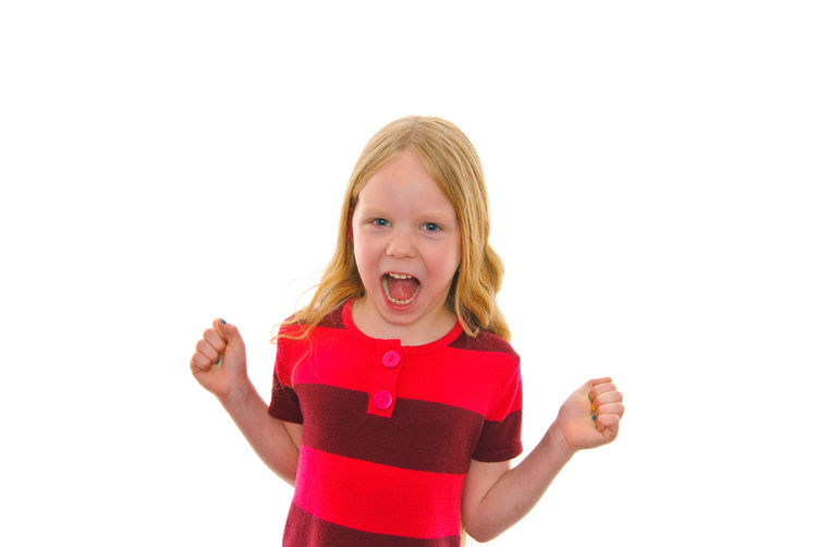 little blond girl freaking out Childhood White Background Child Studio Shot Blond Hair Girls Front View Emotion Mouth One Person Portrait Indoors  Mouth Open Hair Looking At Camera Copy Space Casual Clothing Waist Up Innocence Hairstyle Pre-adolescent Child Making A Face Excitement Freaking Out Happiness