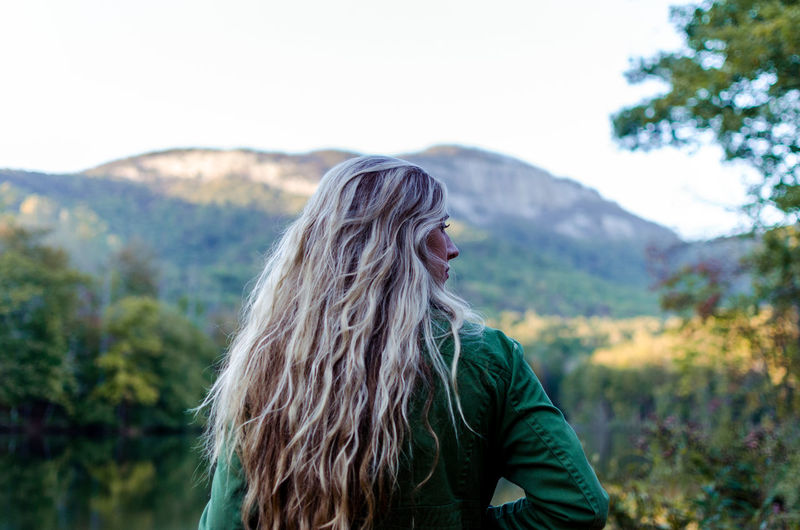 Beautiful Woman Beauty In Nature Blond Hair Day Focus On Foreground Leisure Activity Long Hair Mountain Nature One Person Outdoors People Real People Tree Young Adult Young Women
