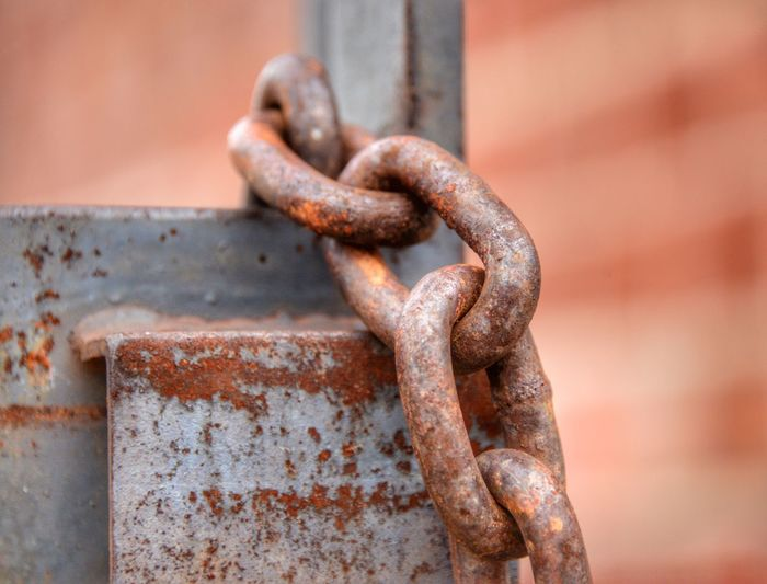 Close-up of rusty chain on metal