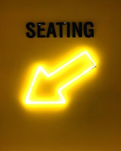 Seating Seating Area Seating Communication Illuminated Sign Text Lighting Equipment Yellow Light - Natural Phenomenon Connection Glowing Symbol No People Arrow Symbol Electricity  Technology Safety Western Script Close-up Indoors  Direction Computer Icon