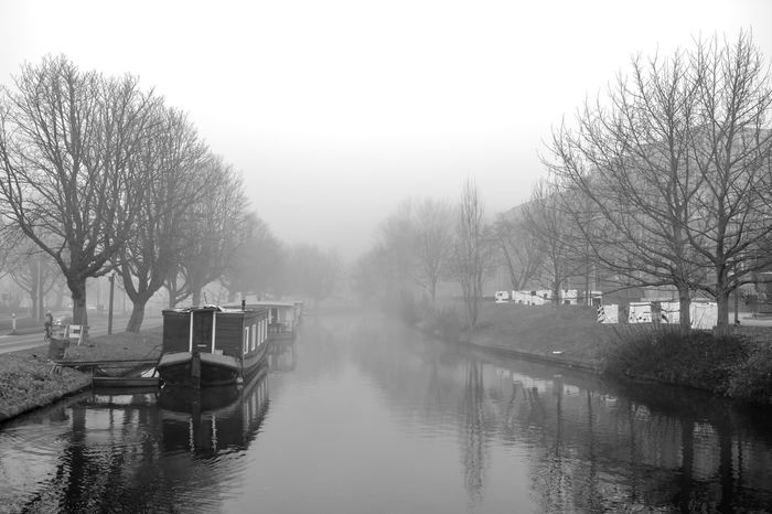 Bare Tree Black And White Canal Day Dutch Landscape Fog Foggy Foggy Morning Landscape Leiden Monochrome Nature Nautical Vessel Nederland No People Outdoors Reflection Sky Still Life Tree Water The City Light