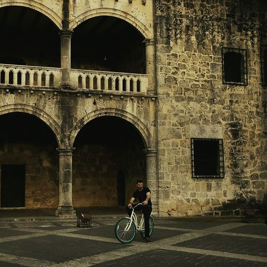 Arch Architecture Bicycle One Man Only Cycling Built Structure Travel Destinations Building Exterior Day Vacations Colonial Architecture Colonial