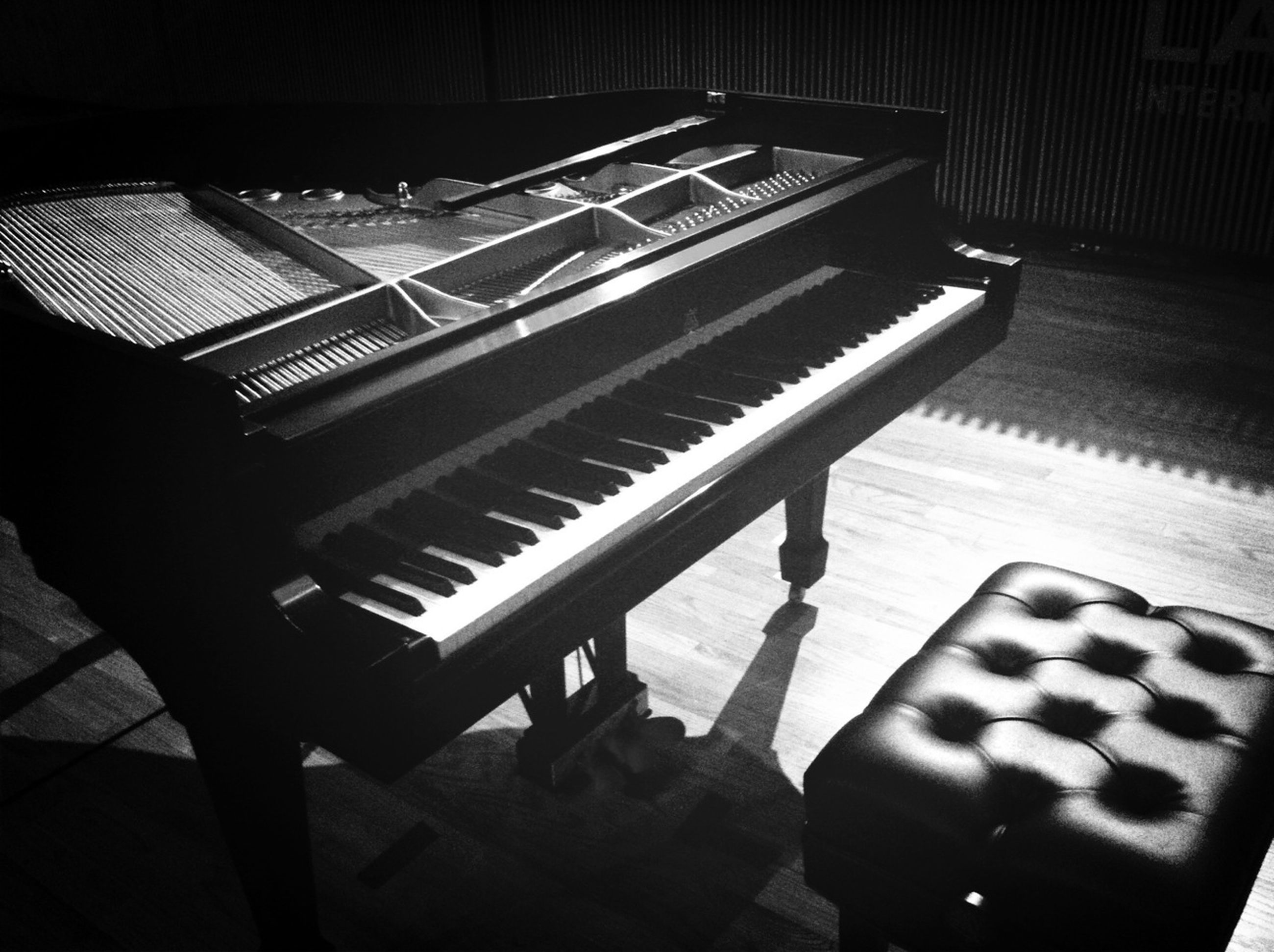 indoors, high angle view, shadow, steps, steps and staircases, staircase, empty, table, chair, piano, musical instrument, absence, arts culture and entertainment, music, wood - material, in a row, sunlight, seat, railing, piano key