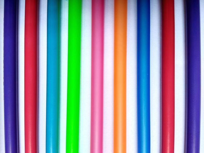 Full frame shot of colorful pipes on table