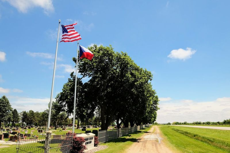 Visual journal May 2017 Wilber, Nebraska Bohemian National Cemetery Also known as: Big Blue Cemetery, Česko Národní Hřbitov A Day In The Life Americans Camera Work Cloud - Sky Czech Flag Day Everyday Lives Flag FUJIFILM X-T1 Memorial Day No People Outdoors Patriotism Photo Diary Practicing Photography Rural America Sky Small Town Stories Taking Pictures Tree Visual Journal