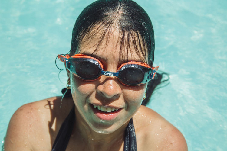 Asperger Childhood Close-up Day Front View Happiness Headshot Leisure Activity Lifestyles Looking At Camera One Person Outdoors People Portrait Real People Smiling Swimming Swimming Goggles Swimming Pool Vacations Water Wet Young Adult