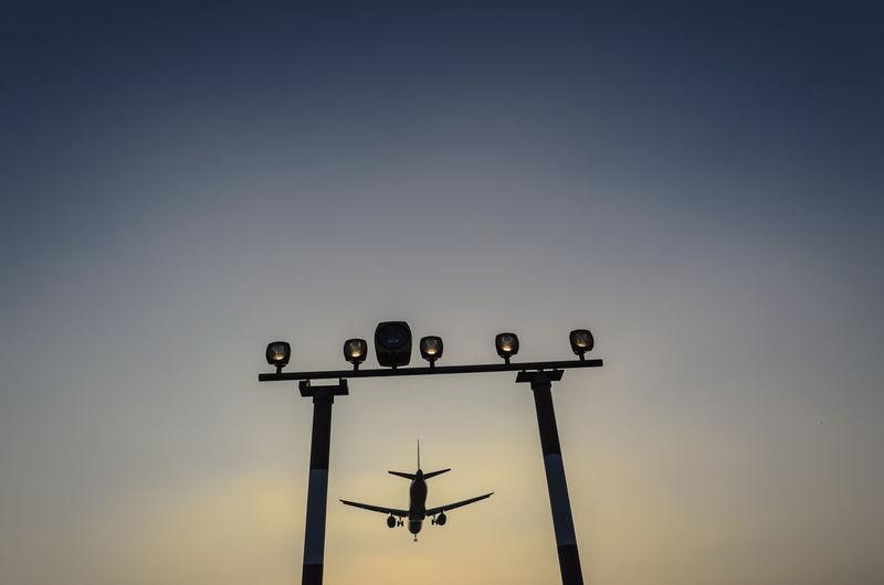 Airplane landing at berlin tegel airport at dusk