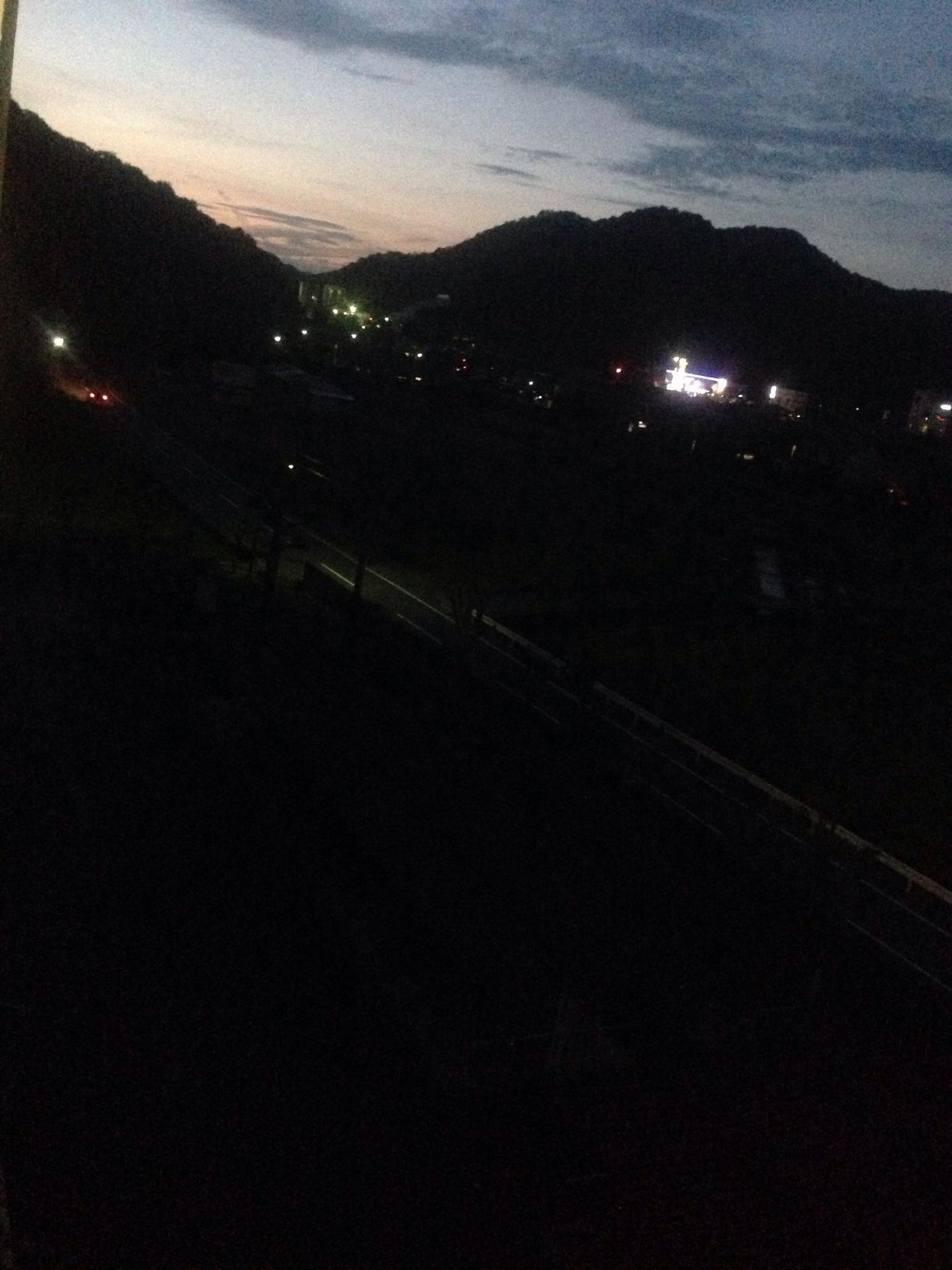 mountain, night, illuminated, sky, transportation, mountain range, scenics, silhouette, dusk, tranquil scene, landscape, beauty in nature, tranquility, sunset, nature, road, dark, outdoors, no people, cloud - sky
